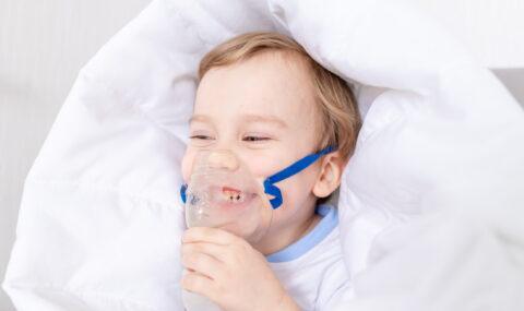 sick-baby-boy-with-inhaler-treats-throat-home-concept-health-inhalation-treatment